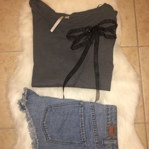 Grey shirt with black bow